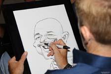 Cartoonist schetst karikaturen bij Wienerberger tijdens Batibouw 2016