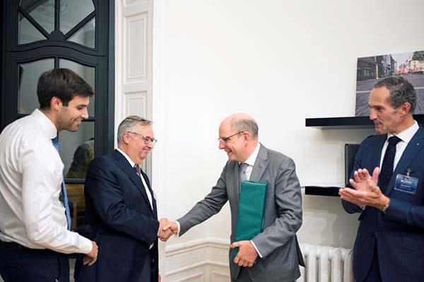 Professionele syndicus Syncura heropent kantoor in Brussel met Minister van Justitie Koen Geens