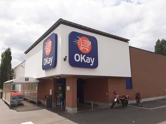 Eerste grootschalig Belgisch project met luchtzuiverende gevelverf bij winkelketen OKay
