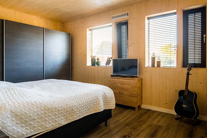 Volledig remontabele houten huizen met vraaggestuurde ventilatie