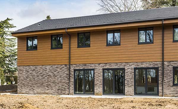 Rockpanel Woods geeft uitbreiding De Pijl warm en huiselijk karakter