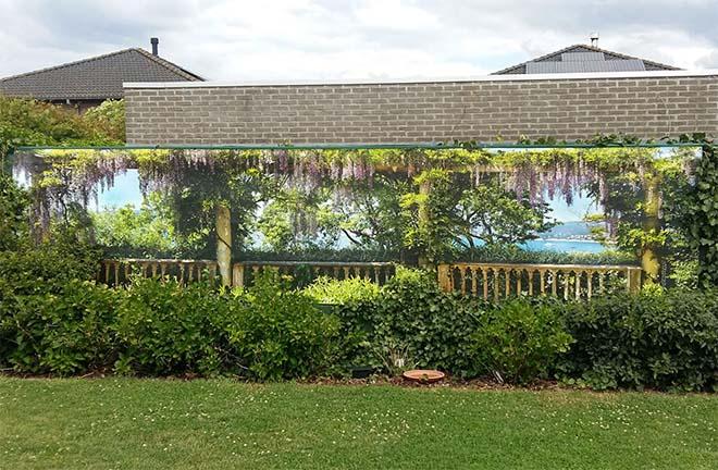 Met een tuinposter maak je komaf met lelijke muren