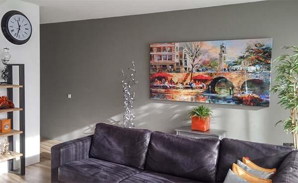 Een canvas doek fleurt op of geeft de ruimte extra pit