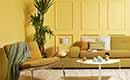 Je woonkamer een vrolijke tint geven